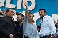 """(From L to R) Silvio Berlusconi MEP, Matteo Salvini MP & Giorgia Meloni MP.<br /> <br /> Rome, 19/10/2019. Today, tens thousands of people (200,000 for the organisers, 50,000 for the police) gathered in Piazza San Giovanni to attend the national demonstration """"Orgoglio Italiano"""" (Italian Pride) of the far-right party Lega (League) of Matteo Salvini. The demonstration was supported by Silvio Berlusconi's party Forza Italia and Giorgia Meloni's party Fratelli d'Italia (Brothers of Italy, right-wing).  <br /> The aim of the rally was to protest against the Italian coalition Government (AKA Governo Conte II, Conte's Second Government, Governo Giallo-Rosso, 1.) lead by Professor Giuseppe Conte. The 66th Government of Italy is a coalition between Five Star Movement (M5S, 2.), Democratic Party (PD – Center Left, 3.), and Liberi e Uguali (LeU – Left, 4.), these last two parties replaced Lega / League as new members of a coalition based on Parliamentarian majority as stated in the Italian Constitution. The Governo Conte I (Conte's First Government, 5.) was 14-month-old when, between 8 and 9 of August 2019, collapsed after the Interior Minister Matteo Salvini withdrew his euroskeptic, anti-migrant, right-wing Lega / League (6.) from the populist coalition in a pindaric attempt (miserably failed) to trigger a snap election.<br /> <br /> Footnotes & Links:<br /> 1. http://bit.do/feK6N<br /> 2. http://bit.do/e7JLx<br /> 3. http://bit.do/e7JKy<br /> 4. http://bit.do/e7JMP<br /> 5. http://bit.do/e7JH7<br /> 6. http://bit.do/eE7Ey<br /> https://www.leganord.org<br /> http://bit.do/feK9X (Source, TheGuardian.com)<br /> Reportage: """"La Fabbrica Della Paura"""" (The Factory of Fear): http://bit.do/feLcy (Source Report, Rai.it - ITA)<br /> (Update) Reportage: """"La Fabbrica Social Della Paura"""" (The Social Network Factory of Fear): http://bit.do/fe8Pn (Source Report, Rai.it - ITA)"""