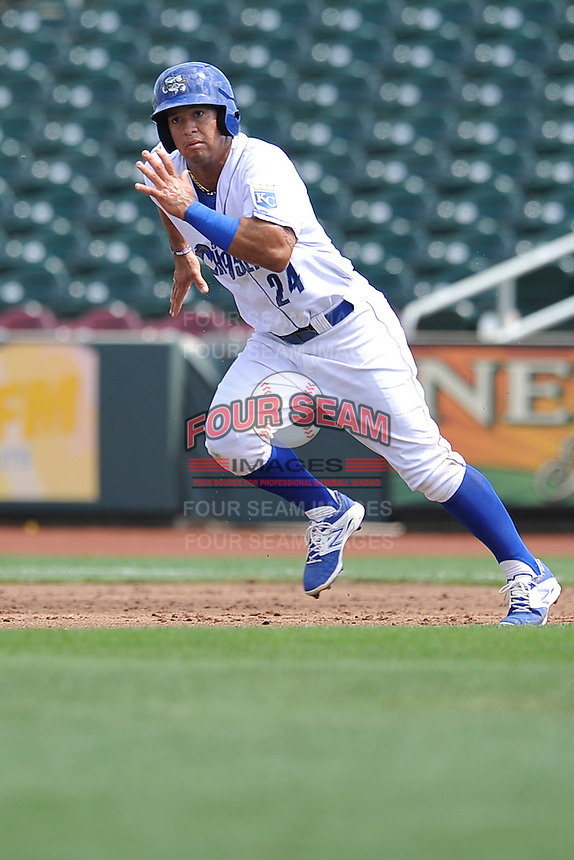 Cheslor Cuthbert #24 of the Omaha Storm Chasers runs to second base against the Las Vegas 51s at Werner Park on August 17, 2014 in Omaha, Nebraska. The Storm Chasers  won 4-0.   (Dennis Hubbard/Four Seam Images)