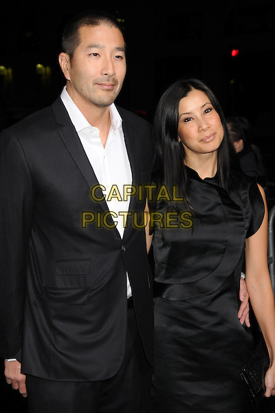 "PAUL SONG & LISA LING.""Ninja Assassin"" Los Angeles Premiere held at Grauman's Chinese Theatre, Hollywood, California, USA..November 19th, 2009.half length black suit jacket sleeveless dress married husband wife .CAP/ADM/BP.©Byron Purvis/AdMedia/Capital Pictures."