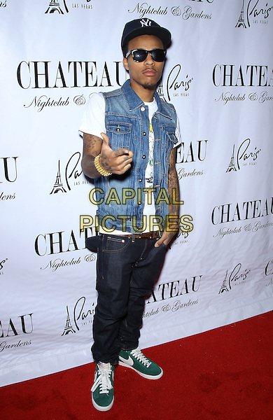Bow Wow aka Shad Gregory Moss.Bow Wow walks the red carpet at Chateau Nightclub inside The Paris Las Vegas,  Las Vegas, Nevada, USA, .14th January 2012..full length cap hat sunglasses denim sleeveless  shirt white t-shirt jeans trainers  nike green  thumb up hand gesture .CAP/ADM/MJT.© MJT/AdMedia/Capital Pictures.