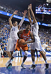Forward Derek Willis and Forward Marcus Lee guard a shot during the game against the Florida Gators at Rupp Arena on February 6, 2016 in Lexington, Kentucky. Kentucky defeated Florida 80-61.