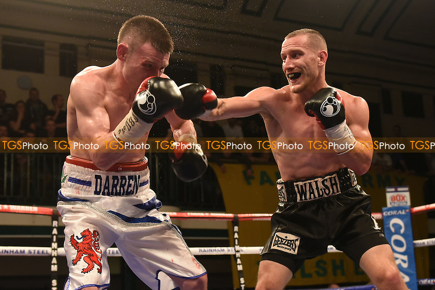 Ryan Walsh (black shorts) defeats Darren Traynor during a Boxing Show at York Hall, promoted by Frank Warren