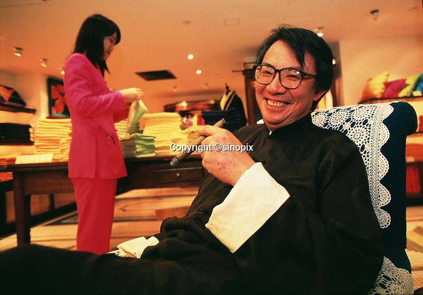 210597: DAVID TANG: HONG KONG<br /> <br /> Hong Kong businessman and socialite, David Tang, poses in his Hong Kong fashion house Shanghai Tang in Central District Hong Kong.<br /> <br /> PHOTO BY RICHARD JONES / SINOPIX