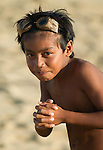 Boy with homemade dive goggles, Sepi Beach, Lombok, Indonesia