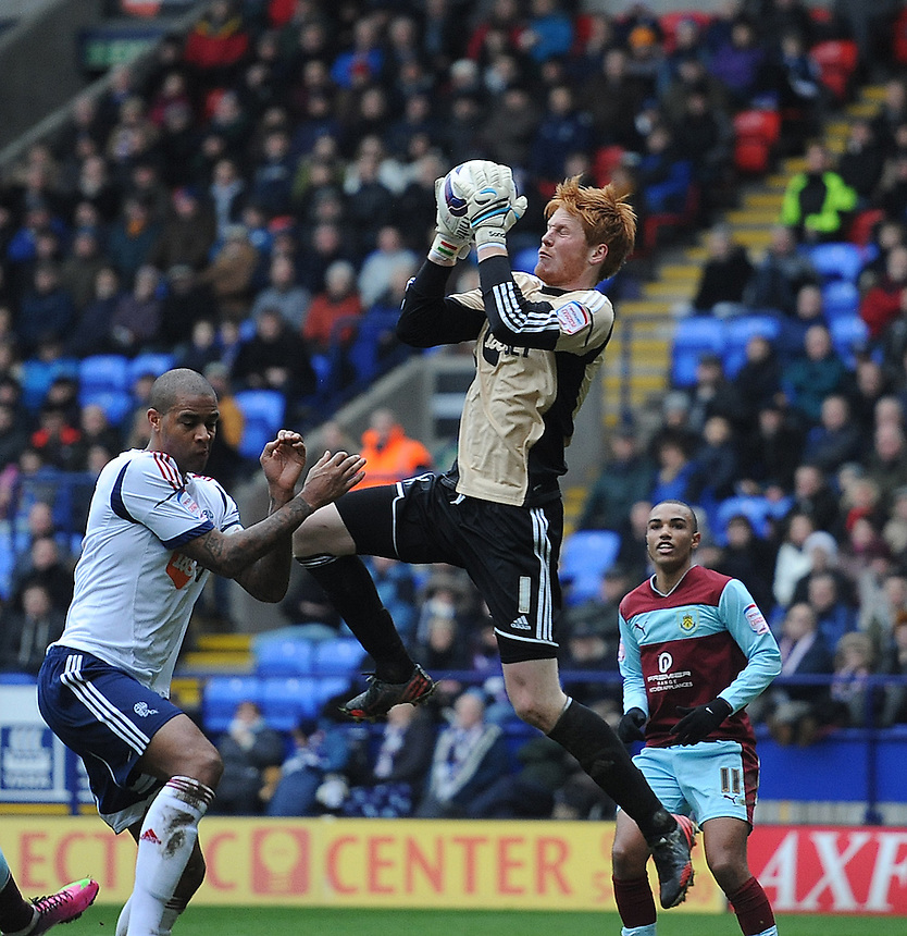 Bolton Wanderers' goalkeeper Adam Bogdan collect the ball protected by team-mate Zat Knight ..Football - npower Football League Championship - Bolton Wanderers v Burnley  - Saturday 9th February 2013 - Reebok Stadium - Bolton..
