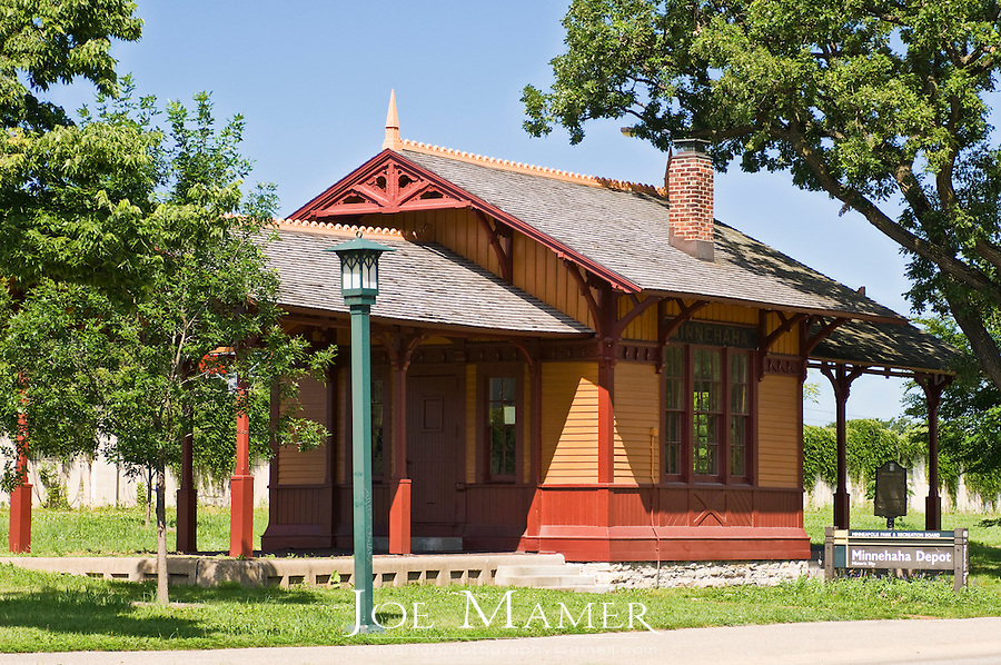 Minnehaha Depot at Minnehaha Park...Milwaukee Road station agents affectionately referred to the quaint little Minnehaha Depot as Òthe Princess.Ó Its delicate gingerbread architecture is reminiscent of the Victorian era when ladies in bustles and gentlemen in high collars traveled largely by train...The first track connecting Minneapolis with Mendota was laid in 1865 by the Minnesota Central Railway, the predecessor of the Chicago,  Milwaukee and St. Paul Railway. The Princess was built in the mid 1870s to replace a smaller station here. Throngs of picnickers and sightseers took the sixteen-minute ride from Minneapolis to Minnehaha Park and the old Longfellow Gardens Zoo, while others traveled to and from Fort Snelling and Mendota. In 1920 three trains made thirteen round trips daily to the depot. It was the scene of feverish activity during World Wars I and II because of the military traffic in and out of Fort Snelling...The Milwaukee Road closed the station in August 1963, and presented it to the Minnesota Historical Society in 1964..