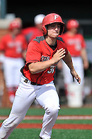 Catcher Kevin Radziewicz (31) of the Fairfield Stags runs toward first in a game against the Charlotte 49ers on Saturday, March 12, 2016, at Hayes Stadium in Charlotte, North Carolina. (Tom Priddy/Four Seam Images)