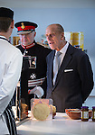 © Joel Goodman - 07973 332324 . No syndication permitted . 14/11/2013 . Manchester , UK . Prince Philip the Duke of Edinburgh checks out some of the food in the canteen . Queen Elizabeth II and the Duke of Edinburgh visit the Coop building at 1 Angel Square , Manchester , this morning ( 14th November 2013 ) . Photo credit : Joel Goodman