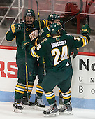 Brady Shaw (UVM - 22), Jonathan Turk (UVM - 8), Chris Muscoby (UVM - 24) - The visiting University of Vermont Catamounts defeated the Northeastern University Huskies 6-2 on Saturday, October 11, 2014, at Matthews Arena in Boston, Massachusetts.