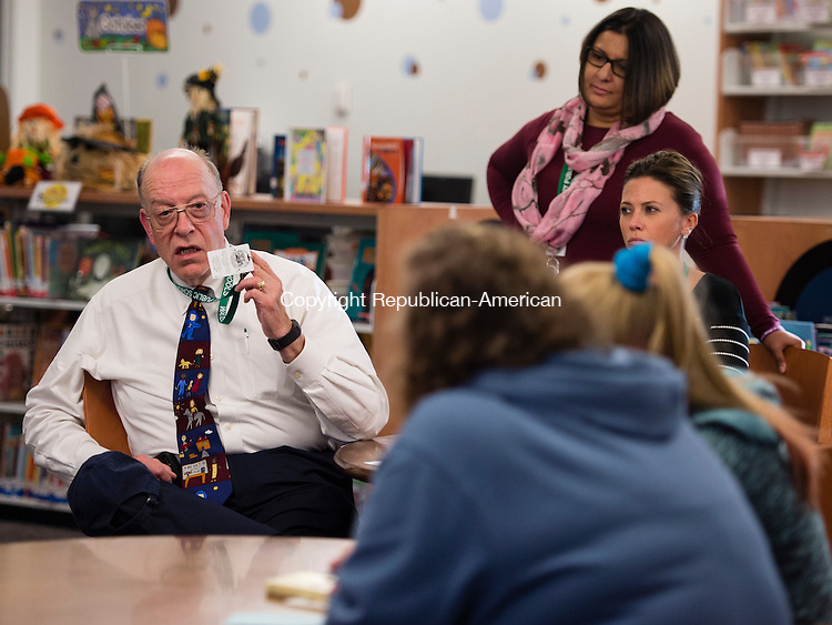TERRYVILLE, CT- 11 October 2016-101116EC19-  John Herman, the security and school safety coordinator at Gilmartin Elementary School in Waterbury, talks to a parent at during a safety forum Tuesday night. Erin Covey Republican-American