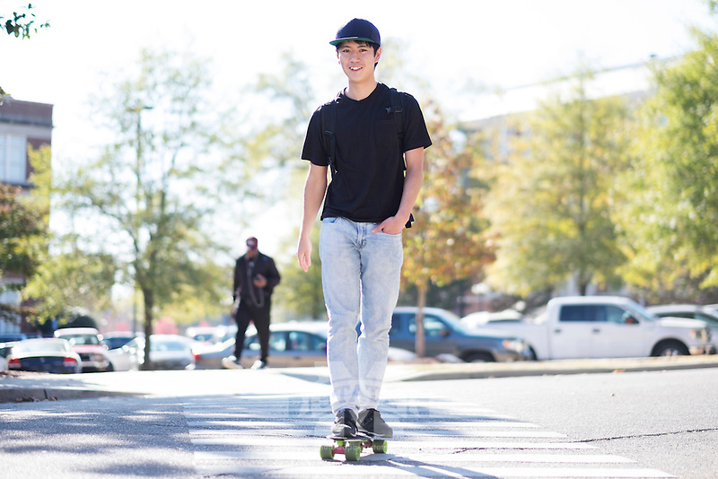 Student skateboarding across Lee Blvd. <br />  (photo by Megan Bean / &copy; Mississippi State University)