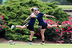 CARY, NC - MAY 18: Jaycie Johnson (right) and Elizabeth Eddy (4) do stretching exercises. The North Carolina Courage held a training session on May 18, 2017, at WakeMed Soccer Park Field 5 in Cary, NC.