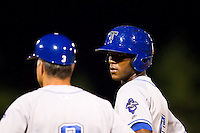 Hector Gomez (5) of the Tulsa Drillers talks with hitting coach Dave Hajek (3) on first during a game against the Springfield Cardinals at Hammons Field on July 19, 2011 in Springfield, Missouri. Tulsa defeated Springfield 17-11. (David Welker / Four Seam Images)