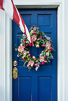 Flower wreath on door with American flag, Lewes, Delaware, USA