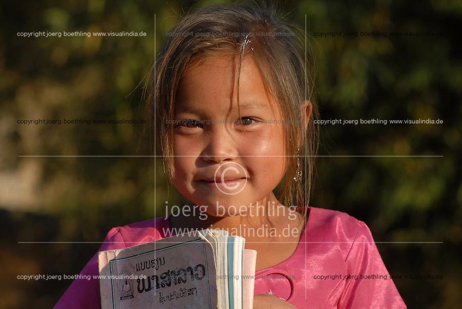 Laos, Hmong village Nam Kha, girl with school books on way to school / Laos, Hmong Dorf Nam Kha , Maedchen mit Schulscachen auf dem Weg zur Schule