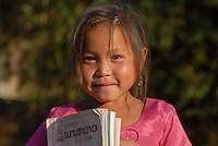 Laos, Hmong village Nam Kha, girl with school books on way to school / Laos, Hmong Dorf Nam Kha , Maedchen mit Schulscachen auf dem Weg zur Schule