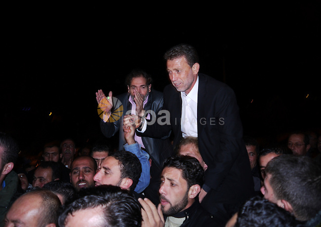 Palestinian freed prisoner Nael Barghouti and his bride Amal Nafea are greeted by relatives and friends during their wedding, in the West Bank city of Ramallah on Nov. 18,2011. Nael Barghouti released from the Israeli jails after 34 years in prison after the swap with the Israeli soldier Gilad Shalit, Amal also jailed for 10 years in Israeli prisons. Photo by Issam Rimawi