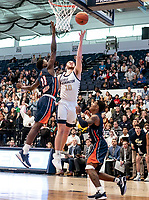 WASHINGTON, DC - NOVEMBER 16: Jamison Battle #10 of George Washington lobs a shot over Malik Miller #11 of Morgan State during a game between Morgan State University and George Washington University at The Smith Center on November 16, 2019 in Washington, DC.