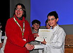 17 April 2010:  Joshua Wolfstein, a student from Eve Dubois' 6th Grade Class at Shelburne's Renaissance School accepts an achievement award from Tricia Finkle at the 2010 Vermont State Science and Mathematics Fair held at Norwich University, in Northfield, Vermont. Josh also received a Gold Medal and a cash prize for his project comparing wood and grass pellet renewable energy fuels. Mandatory Photo Credit: Ed Wolfstein Photo