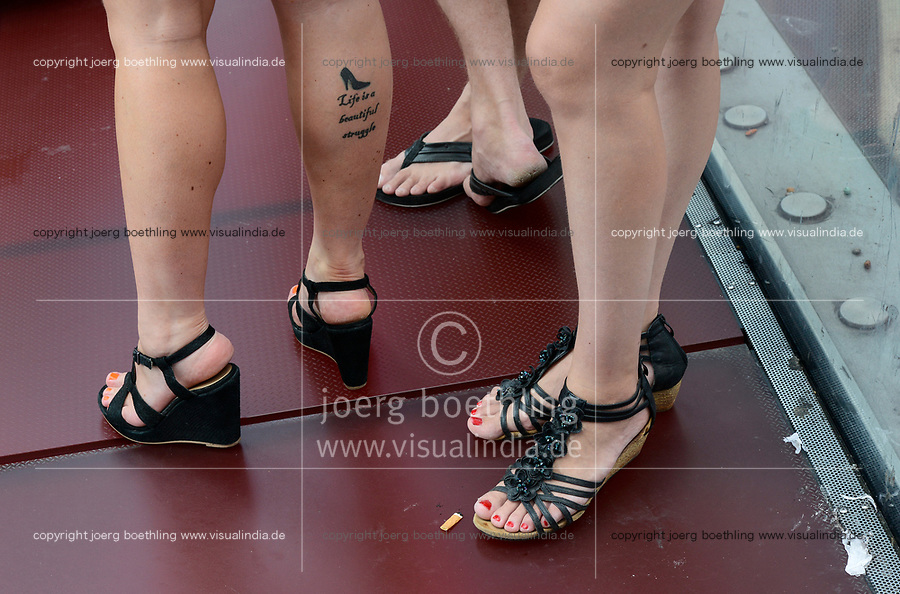 USA, New York City, Manhattan, Time square, woman legs with tattoo Life is beautiful struggle