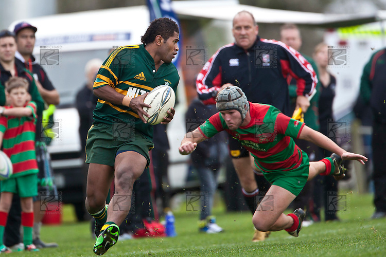 Peni Buakula evades the tackle of Matty Hamilton. Counties Manukau McNamara Cup Premier Club Rugby final between Pukekohe andWaiuku, held at Bayer Growers Stadium, on Saturday July 17th. Waiuku won 25 - 20.