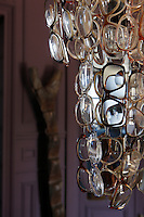 A detail of the quirky chandelier in the entrance hall which is made of old pairs of spectacles