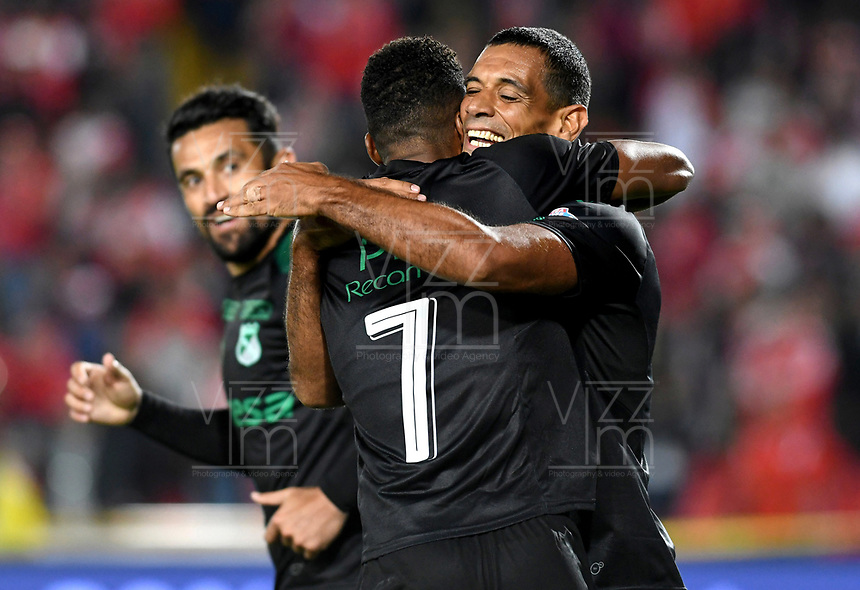 BOGOTÁ - COLOMBIA, 29-09-2018: Jhon Edison Mosquera (#7), jugador del Cali, celebra despues de anotar el segundo gol de su equipo durante el partido entre Independiente Santa Fe y Deportivo Cali por la fecha 12 de la Liga Águila II 2018 jugado en el estadio Nemesio Camacho El Campín de la ciudad de Bogotá. / Jhon Edison Mosquera (#7), player of Cali, celebrates after scoring the secoond goal o his team during the match between Independiente Santa Fe and Deportivo Cali for the date 12 of the Liga Aguila II 2018 played at the Nemesio Camacho El Campin Stadium in Bogota city. Photo: VizzorImage/ Julian Medina / Cont