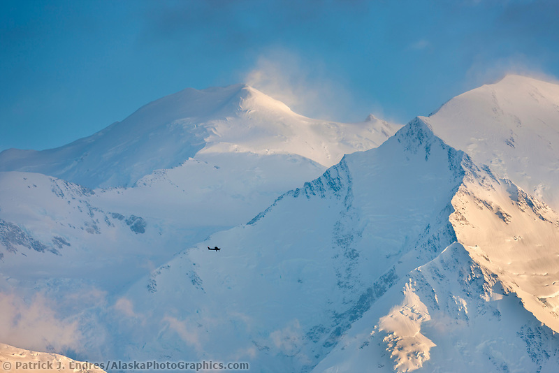 Small bush plane by Kantishna Air takes flightseeing tour by the north and south summits of Denali, North America's highest mountain, view from Eielson Bluffs, Denali National Park, Interior, Alaska.
