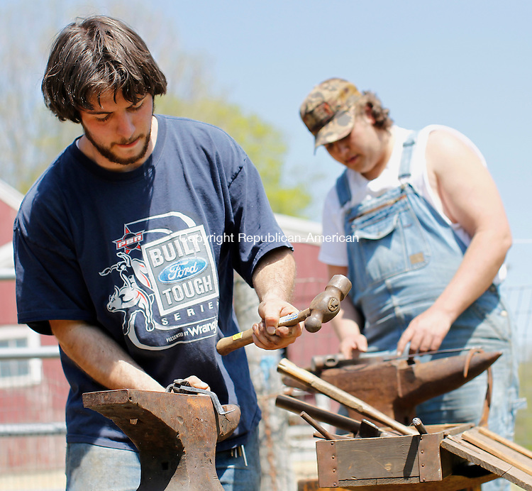 Woodbury, CT-01, May 2010-050110CM11 COUNTRY LIFE USE Blacksmith's, Joe Mangimi (left) and Michael Morgante, of Woodbury make hearth cooking tools Saturday afternoon at the Woodbury Farm Day, at the Flander's Nature Center.   --Christopher Massa Republican-American