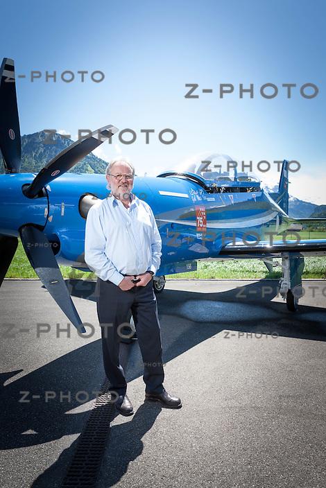 23.5.2014 STANS / NW PORTRAIT VON OSCAR J. SCHWENK VERWALTUNGSRATSPRAESIDENT DER PILATUS AIRCRAFT LTD. IM HINTERGRUND EINE PC-21 FUER SAUDI ARABIEN AM 23. MAI 2014 IM HAUPTSITZ IN STANS /NW <br /> <br /> COPYRIGHT &copy; ZVONIMIR PISONIC