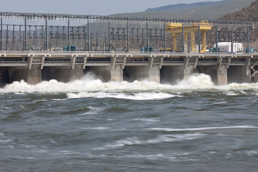 Water spills over a dam in Washington State, generating power.