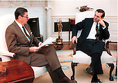 Washington, DC - File photo -- United States President Ronald Reagan meets with Donald Rumsfeld, new Ambassador to the Middle East, in the Oval Office.  Photo released November 3, 1983.<br /> Credit: Mary Anne Fackelman - White House via CNP