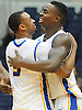 Hempstead, NY - January 11, 2014: Hofstra University teammates No. 24 Stephen Nwaukoni, right, and No. 3 Zeke Upshaw after the Pride's 75-71 win over the College of Charleston in an NCAA men's basketball game at Mack Sports Complex. Nwaukoni recorded a double-double (13 points, 15 rebounds) and Upshaw scored a team-high 22 points as Hofstra rallied from a 14 point first half deficit for the victory. (Photo by James Escher)