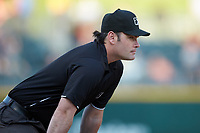 Third base umpire Scott Costello works the International League game between the Toledo Mud Hens and the Charlotte Knights at BB&T BallPark on April 23, 2019 in Charlotte, North Carolina. The Knights defeated the Mud Hens 11-9 in 10 innings. (Brian Westerholt/Four Seam Images)