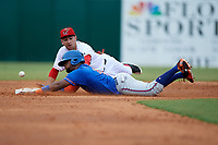 St. Lucie Mets center fielder John Mora (4) slides into second base in front of shortstop Alejandro Salazar (7) during a game against the Florida Fire Frogs on July 23, 2017 at Osceola County Stadium in Kissimmee, Florida.  St. Lucie defeated Florida 3-2.  (Mike Janes/Four Seam Images)