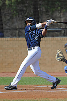 Matthew Scruggs #5 of East Tennessee State University follows through on his swing at Greenwood Field against the the University of North Carolina Asheville on March 2, 2011 in Asheville, North Carolina.  East Tennessee State University won 13-5.  Photo by Tony Farlow / Four Seam Images..