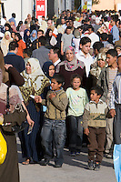 Tripoli, Libya, North Africa - Libyan Men, Women, Families at International Trade Fair.  Clothing Styles.  Young Boys.