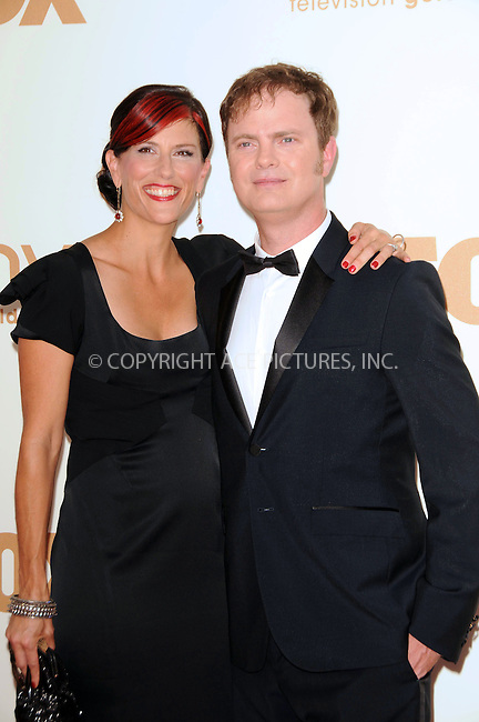 WWW.ACEPIXS.COM . . . . .  ....September 18 2011, LA....Holiday Reinhorn (L) and Rainn Wilson arriving at the 63rd Annual Primetime Emmy Awards held at Nokia Theatre L.A. LIVE on September 18, 2011 in Los Angeles, California....Please byline: PETER WEST - ACE PICTURES.... *** ***..Ace Pictures, Inc:  ..Philip Vaughan (212) 243-8787 or (646) 679 0430..e-mail: info@acepixs.com..web: http://www.acepixs.com