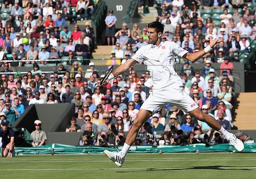 02.07.2016. All England Lawn Tennis and Croquet Club, London, England. The Wimbledon Tennis Championships Day Six. Number 1 seed, Novak Djokovic (SRB) volleys during his singles match against Sam Querry (USA). Querry won in four sets.