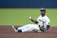 Michigan Wolverines second baseman Ako Thomas (4) looks at the umpire for a call during the NCAA baseball game against the Michigan State Spartans on May 7, 2019 at Ray Fisher Stadium in Ann Arbor, Michigan. Michigan defeated Michigan State 7-0. (Andrew Woolley/Four Seam Images)