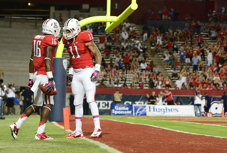 Oct. 20, 2012; Tempe, AZ, USA; Arizona Wildcats wide receiver (16) Garic Wharton is congratulated by wide receiver (11) Tyler Slavin after catching a pass for a touchdown against the Washington Huskies in the second quarter at Arizona Stadium. Mandatory Credit: Mark J. Rebilas-