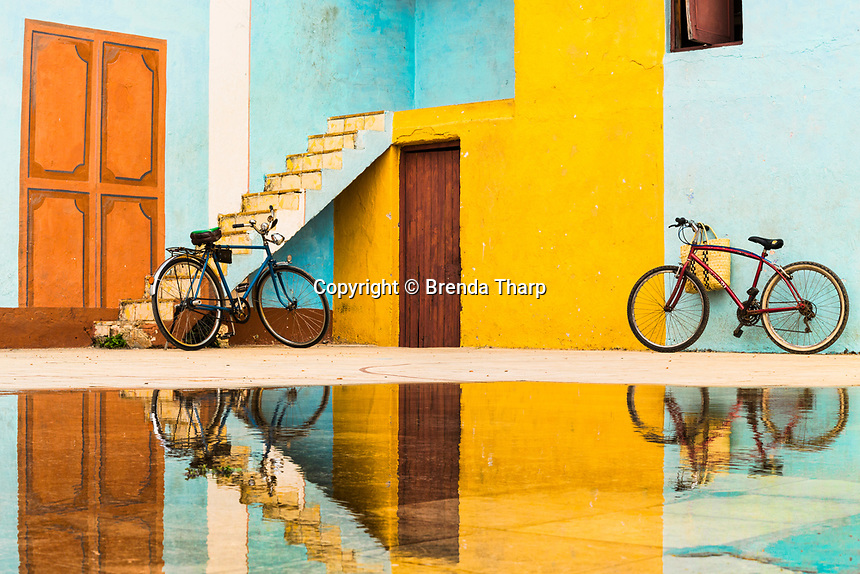 Cuba, Trinidad. Bicycles, trompe l'oeil on buildlings, and reflections.