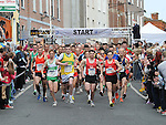 1956 Olympic gold medal winner Ronnie Delaney blows the horn to start the Boyne 10K. Photo: Colin Bell/pressphotos.ie
