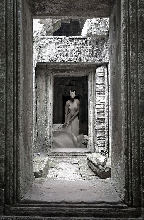 A young woman wearing a mask appears in an ancient temple passageway.