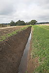 Freshly repaired drainage ditches taking water down the valley side towards the River Deben, Sutton, Suffolk, England