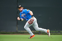 Akron RubberDucks left fielder Clint Frazier (4) tracks a long fly ball during the first game of a doubleheader against the Bowie Baysox on June 5, 2016 at Prince George's Stadium in Bowie, Maryland.  Bowie defeated Akron 6-0.  (Mike Janes/Four Seam Images)