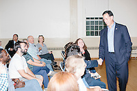 Former Pennsylvania senator and Republican presidential candidate Rick Santorum greets people before speaking at a town hall campaign event at Weare Town Hall in Weare, New Hampshire.