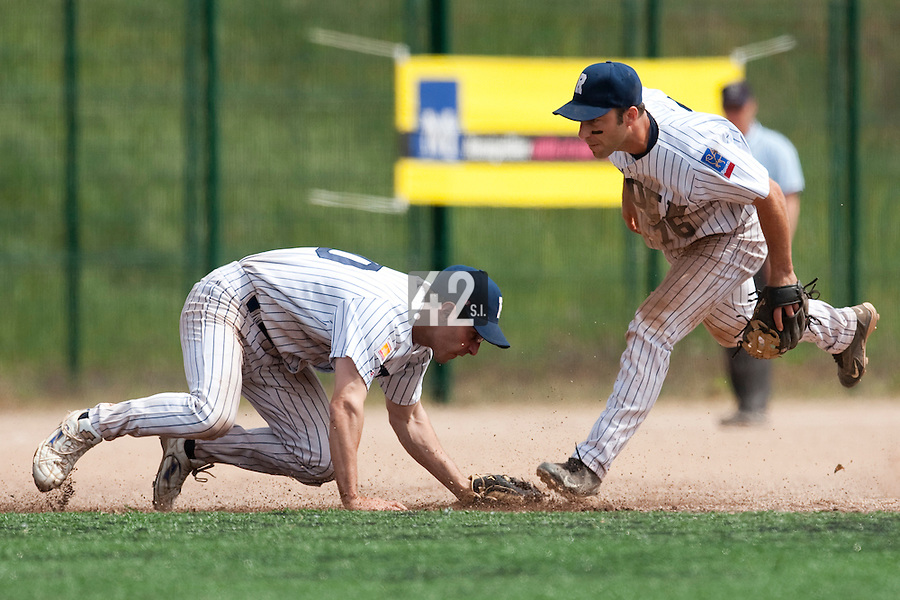 23 May 2009: Olivier Israel of Rouen dives to catch a ball next to Dany Scalabrini during the 2009 challenge de France, a tournament with the best French baseball teams - all eight elite league clubs - to determine a spot in the European Cup next year, at Montpellier, France. Rouen wins 6-2 over La Guerche.