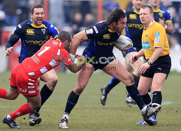 Pix: Chris Mangnall/SWpix.com, Rugby League, Carnegie Challenge Cup Round 4. 20/04/08. Leigh Centurions v Warrington Wolves....picture copyright>>Simon Wilkinson>>07811267 706>>....Leigh's Dennis Moran tackles Warrington's Jon Clarke
