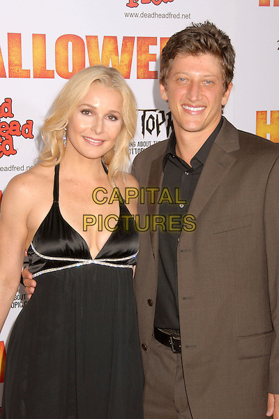 "ELLE TRAVIS & JOHN FEINMAN.""Halloween"" World Premiere at Grauman's Chinese Theatre, Hollywood, California, USA..August 23rd, 2007.half length black halterneck dress brown suit jacket .CAP/ADM/BP.©Byron Purvis/AdMedia/Capital Pictures"